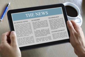 Digital tablet showing news